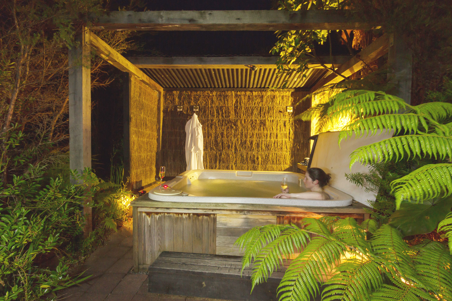 Enjoy a glas of champagne in the rainforest at our night sky spa pool at the Wairua Lodge