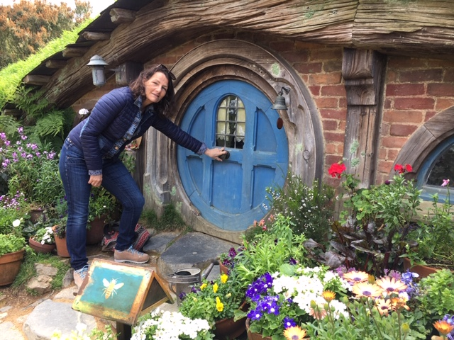 Hobbiton - like the Wairua Lodge itself, a magical place. Debbie opening the small Hobbit door.